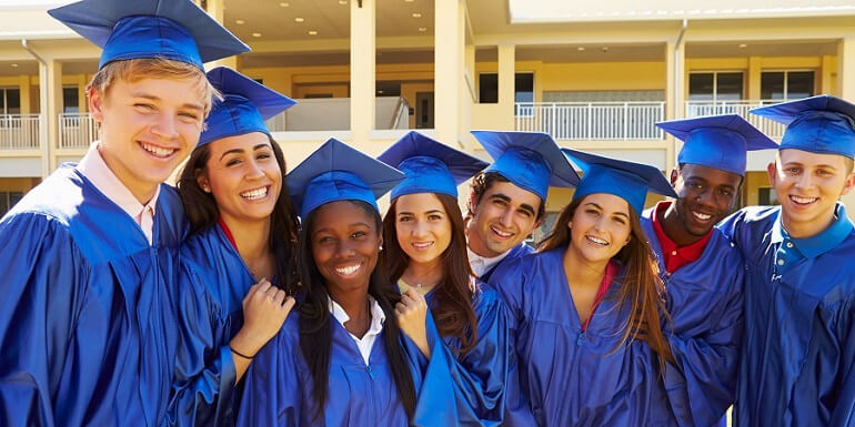 Group of Graduates in Blue Caps and Gowns