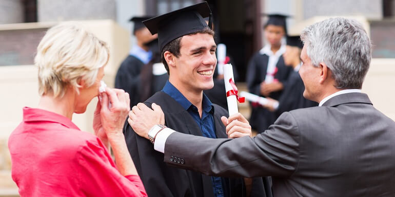 Male Graduate Congratulated by Parents